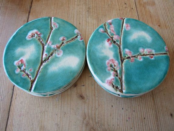 Ceramic coaster with cherry blossoms in a turquoise sky with dreamy white clouds. Made to order in 2 -4 weeks.  I pressed cherry blossom twigs