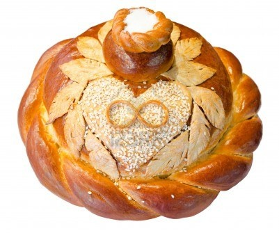 a fresh round loaf of wedding bread, rings on a heart, salt on top  Russian customs and traditions