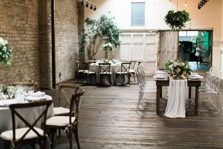 Vineyard Chairs, Ghost Chairs, brick walls and farmhouse tables. This is one beautiful open house! #wedding #events #rentals #chairs