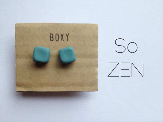 SO ZEN Boxy smoky blue earrings measure approximately one centimetre and are fastened onto surgical steel earring posts.  Boxy Jewellery $ 15
