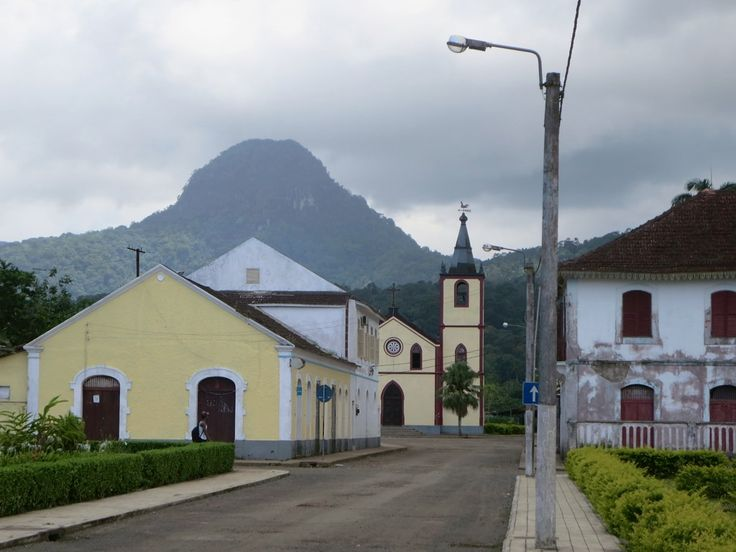 Pico Papagaio (680 meters) rises behind the town of Santo Antonio on Principe Island, São Tomé and Príncipe.