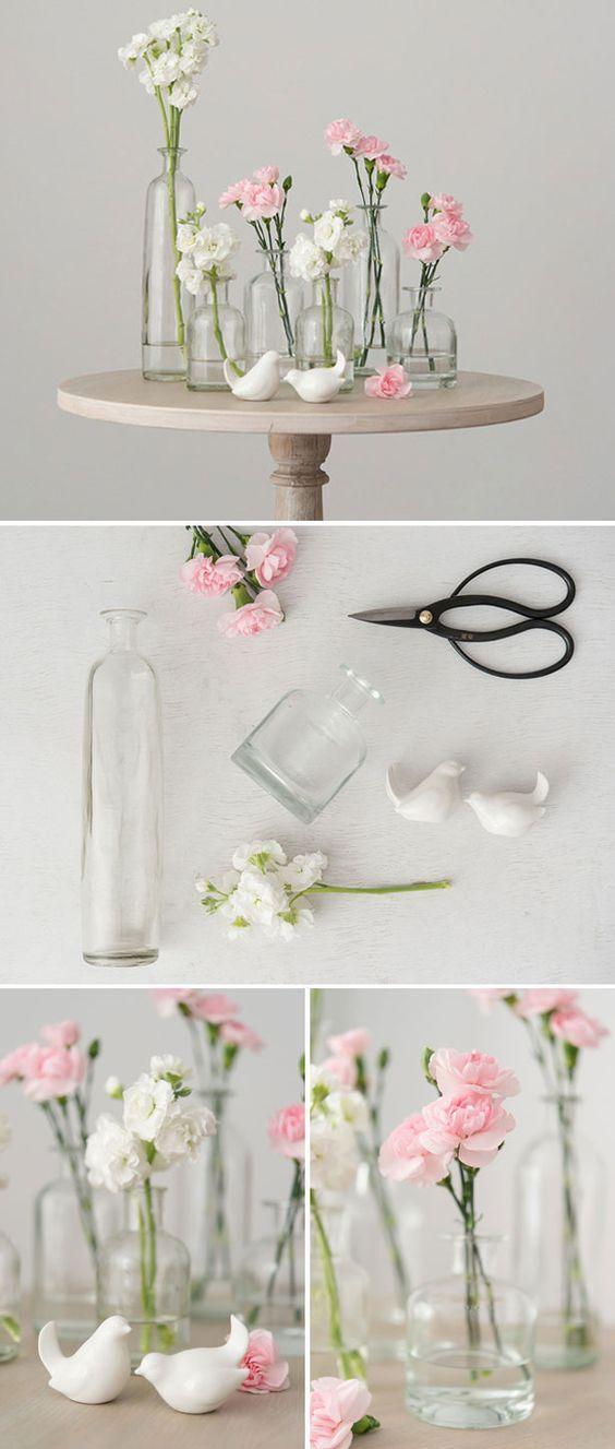 DIY Glass Bottle Set centrepiece / http://www.himisspuff.com/diy-wedding-centerpieces-on-a-budget/10/