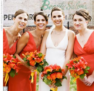 Each of Cindy's three bridesmaids wore cayenne, chiffon, floor-length, bias-cut dresses with V-necks by Watters and Watters.