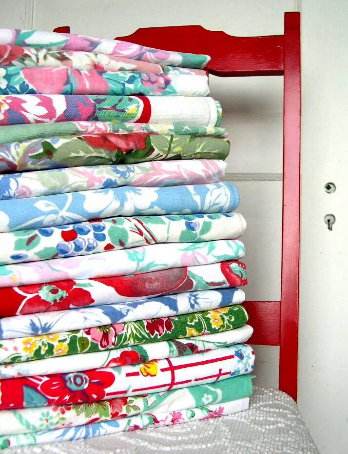 A nice collection of vintage tablecloths...I collect vintage aprons and tablecloths.