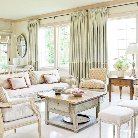 This central seating area is defined by a pair of bergere chairs that flank a French side table. The neutral palette was chosen to create a relaxed setting and to put the design emphasis on the Parisian pieces and antiques.