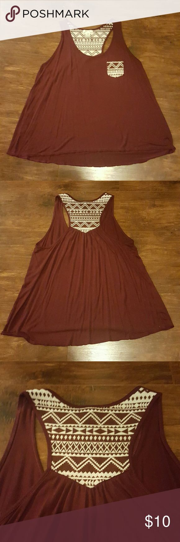 Aztec  top. Cute burgundy with Aztec design on pocket and top back.  Size medium but to me fits more like a small. Tops Tank Tops