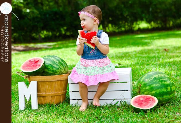 Great props here for a summer session ~ brightly colored watermelon, wood crates, baskets and large wooden letters.