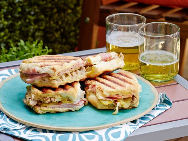 Make Grilled Cubano Sandwiches by marinating pork tenderloin in yellow mustard and pickle juice so the bold, classic flavors of a Cubano sandwich will penetrate the meat.