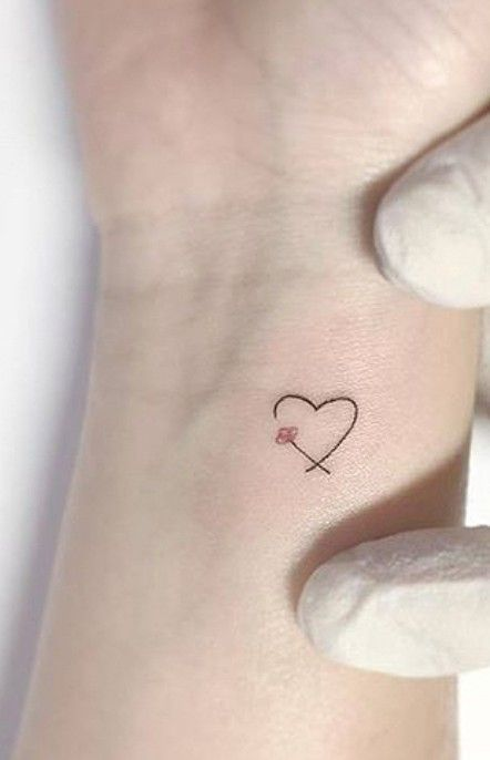 heart with colored beads in place of that flower one representing each person – – #smalltattoos