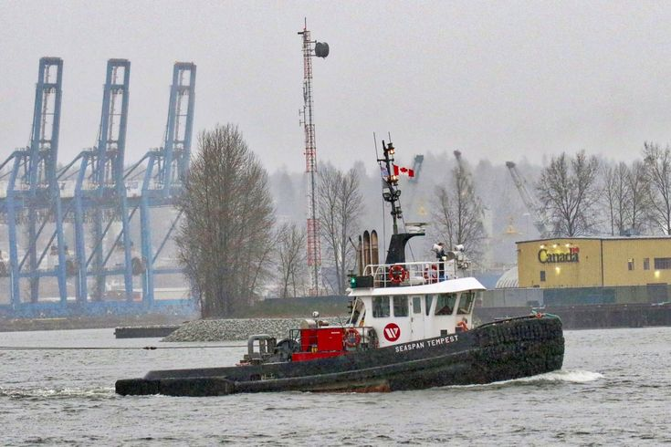 """Seaspan Marine's tugboat """"SEASPAN TEMPEST"""" passes Shoal Point on Annacis Island in the Fraser River. Click image to enlarge."""