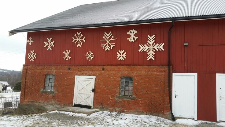 Reclaimed wood snowflake Christmas decorations On my barn in Norway