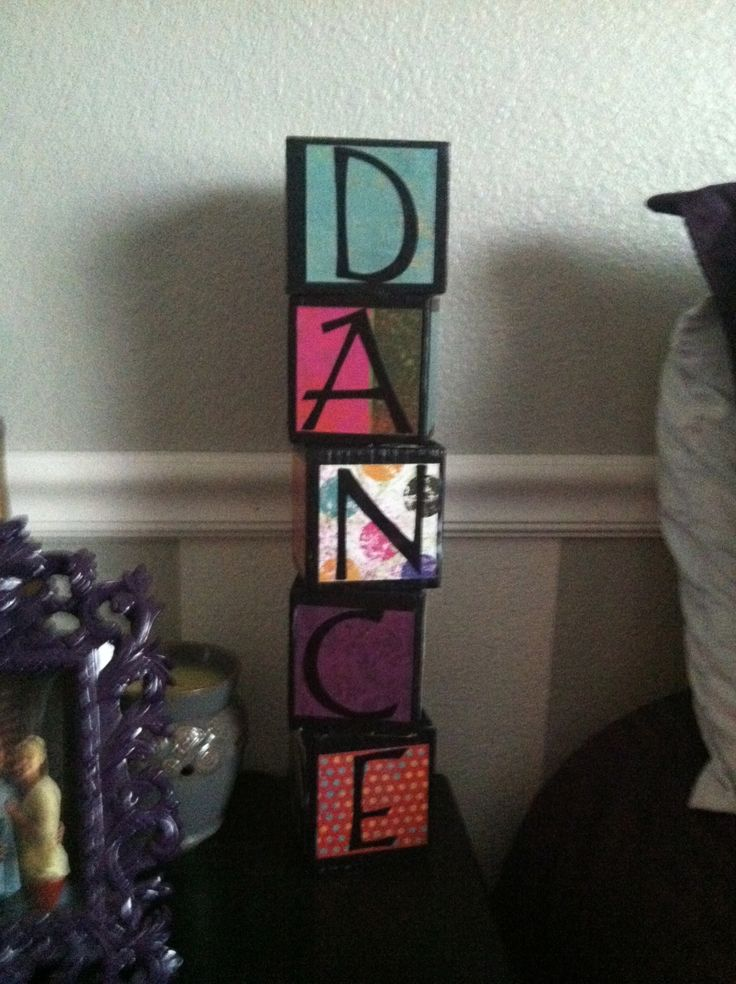Painted wooden blocks. Cardstock paper cut outs mod podged onto blocks. Dance!