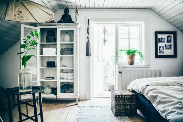 Slouchy Bohemian maximalism and Scandinavian minimalism might seem like opposite ends of the spectrum, style-wise, but this home in Varberg, on Sweden's West Coast, brings them together in the best possible way.