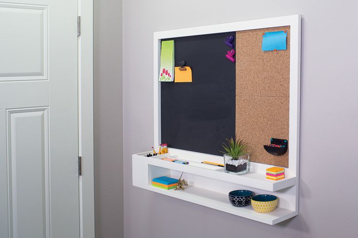 Make use of a blank wall in your entryway or kitchen with a message center that will keep the whole family organized and informed. It features storage, a magnetic chalkboard, and a cork board for pinning up notes.