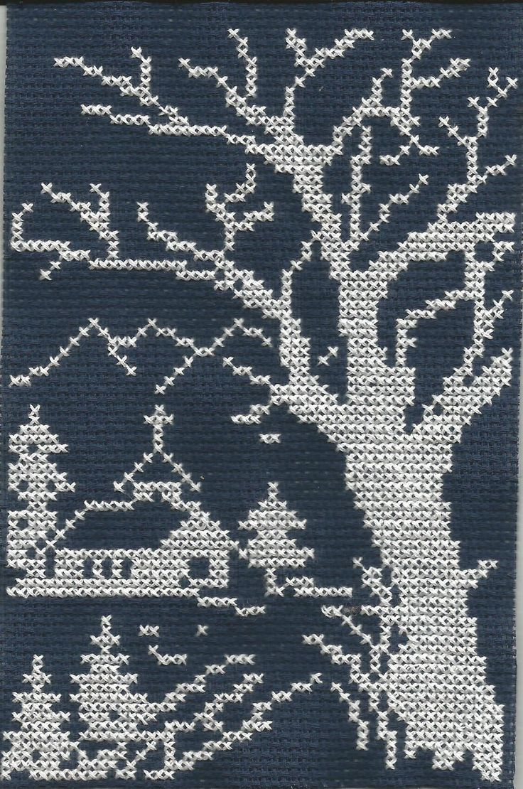 Tree and a church cross stitch.