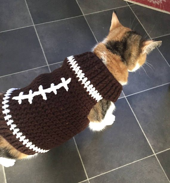 Cat or small dog football sweater, to root for your favorite team on game day! Along the neck, and the bottom have a ribbed edging, to give it a bit of style. This small pet sweater easily slips on over your pets head, so no struggling with buttons. Please make sure to measure your cat or dog to make sure you order the correct size. Because of sanitary reasons, we are unable to accept any returns or exchanges. Large is sized to fit about a 14 pound cat. The neck measures about 14 inches…