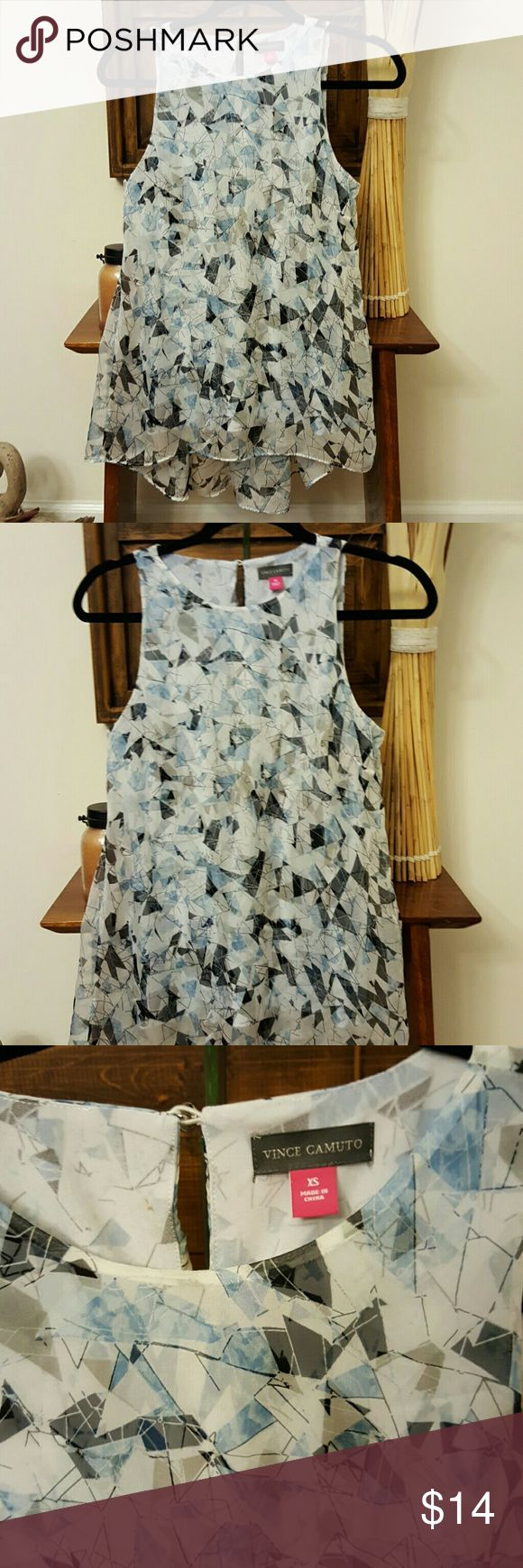 Beautiful tunic. Hues of blue and white Cami style interior with sheer, flowing fabric outside. Great look with leggings. Excellent condition, has one very small spot on inside  next to tag that is not visible when on. Very pretty. Vince Camuto Tops
