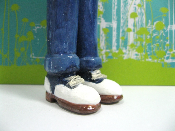 Navy Blue and White Saddle Shoes with Blue Jeans.  Help keep your page with this funky little bookmark.  :)