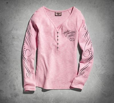 Celebrate every part of the journey in the Pink Label Long Sleeve Henley Tee. Our soft cotton shirt has swirl sleeve accents and sparkly buttons. This is the women's long sleeve top of choice on ladies' ride night.