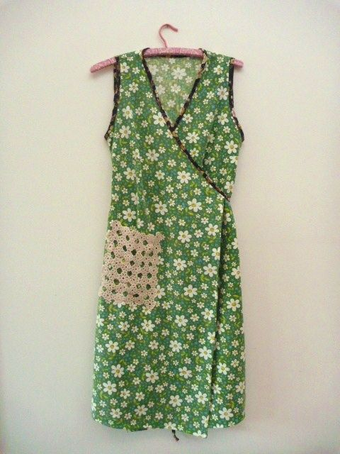 Wrap dress made of vintage cotton sheet.   I remember My Great Aunt wearing one of these around the house to keep her clothes clean.   I need to find some pretty floral fabric and have a go at this.