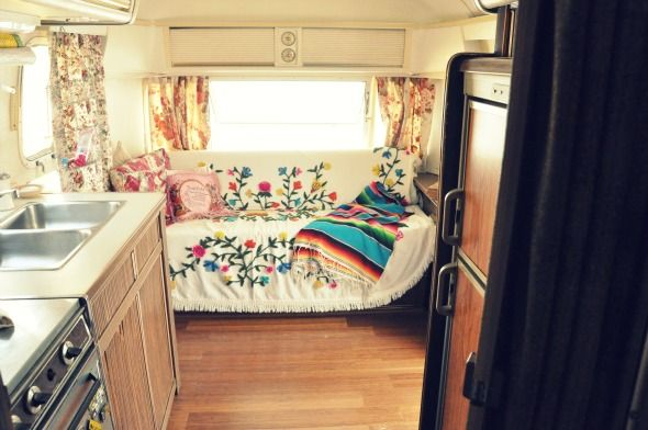 love these curtains, the floor and the pretty blanket over the couch...good ideas for covering up the typical ugly motor home decor