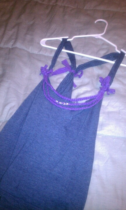 """I made this out of my girlfriends old xl t shirts. No sewing just cut the shirt into a tank by cutting off the sleeves and the collar. Using leftover sleeves cut into strips and braid. Tie  the braids together in descending order then tie them to the front """"straps"""" of the tank top. <3 sum"""