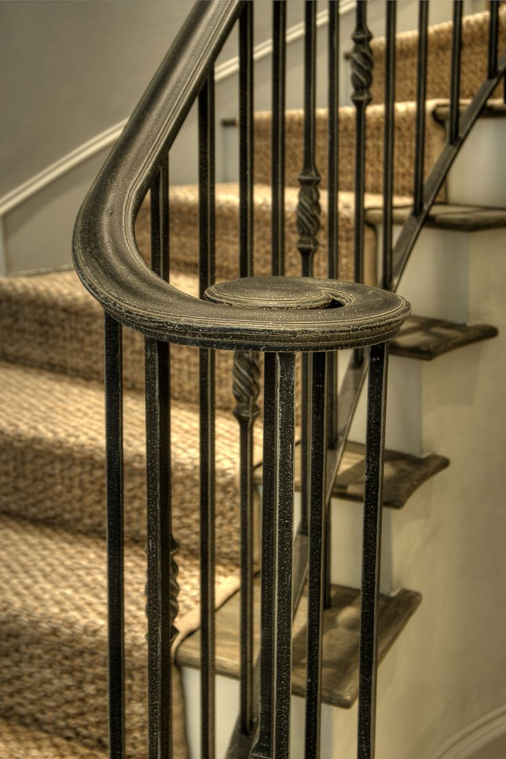 """ Wrought iron staircases add wonderful character to a home.  When painted black, they have the feel of sprayed patio furniture.  A series of subtle milk wash glazes were applied to give it an age-old flavor. """