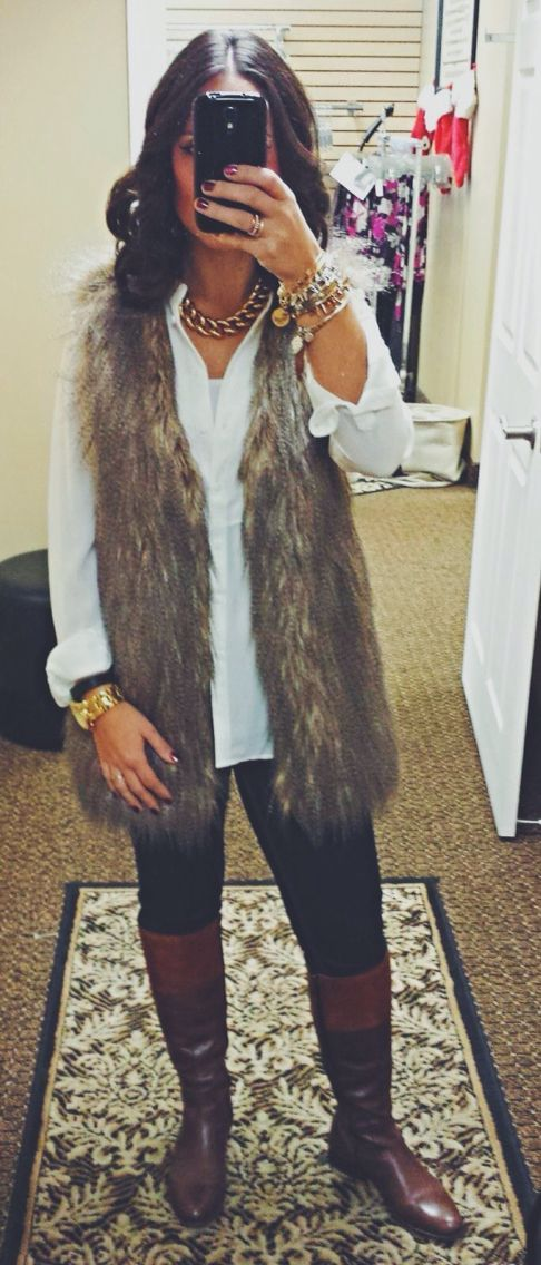 Brown faux fur vest  white collar shirt  black skinnies  Gold jewelery  Brown rider boots