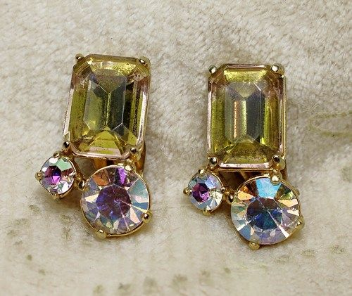 Vintage Schiaparelli Citrine Yellow Art Glass AB Rhinestone Earrings are a wonderful pair of earrings set in a gold plated base with an emerald cut baguette in a citrine color accented by aurora borea