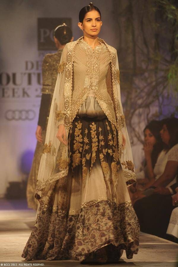 Ericka Packard showcases a creation by designer Anamika Khanna on Day 2 of Delhi Couture Week, held in New Delhi, on August 01, 2013.