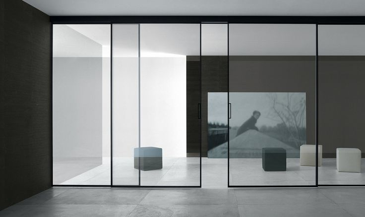 Valeria sliding doors design by Giuseppe Bavuso for Rimadesio. Black anodised aluminium frame and clear reflective glass.
