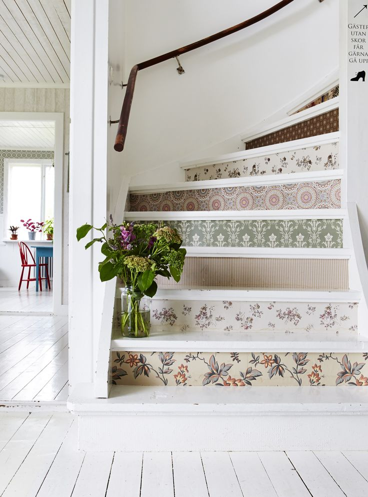 Floral-inspired patterns can pop up in unexpected places, such as stair risers. Lake provides instructions for crafting your own: After removing nails and sanding the stairs, apply a coat of primer followed by floor paint (Farrow & Ball's All White was used here). Choose multiple wallpaper patterns or just one for uniformity, and adhere it with PVA glue.