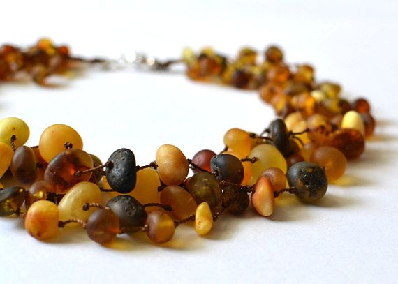 Matt Amber Necklace, colorful amber linen necklace Woodland Inspired Natural Gift Boho Necklace  This particular necklace is made of matt Baltic amber, brown cord and sterling silver clasp. Lovely color of ambers: yellow, olive green, brown, lemon.  Length: 47 cm - 18,5  Net weight: 54g  Your necklace will come carefully wrapped in an eco-friendly gift box.  It makes a grat set with this bracelet  https://www.etsy.com/listing/110349886/matt-amber-bracelet-organic-lin...