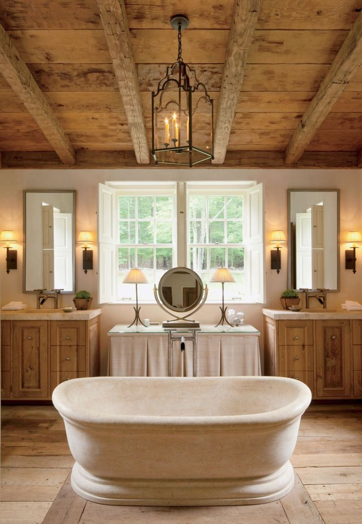 Inspiration Web Design In this rustic master bath of a Connecticut poolhouse by architect Gil Schafer and Interior Designer John Cottrell stands a custom made limestone tub that