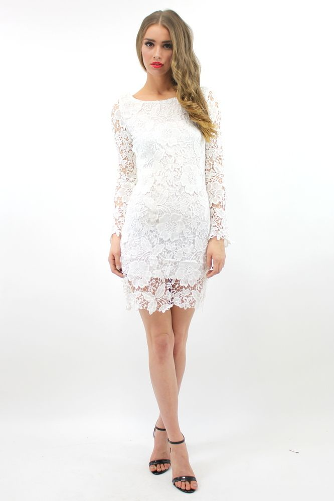 The Lady Lux dress by Lioness is made from a gorgeous, elegant embroidered lace.  Features a round neckline, a sloping 'V' cut down the back and is figure hugging for a sexy look.  The perfect little white dress for all sorts of occasions!Length: 90cmZip fastening at the backSloping V cut at the backScalloped hemline and cuffsRound neckline