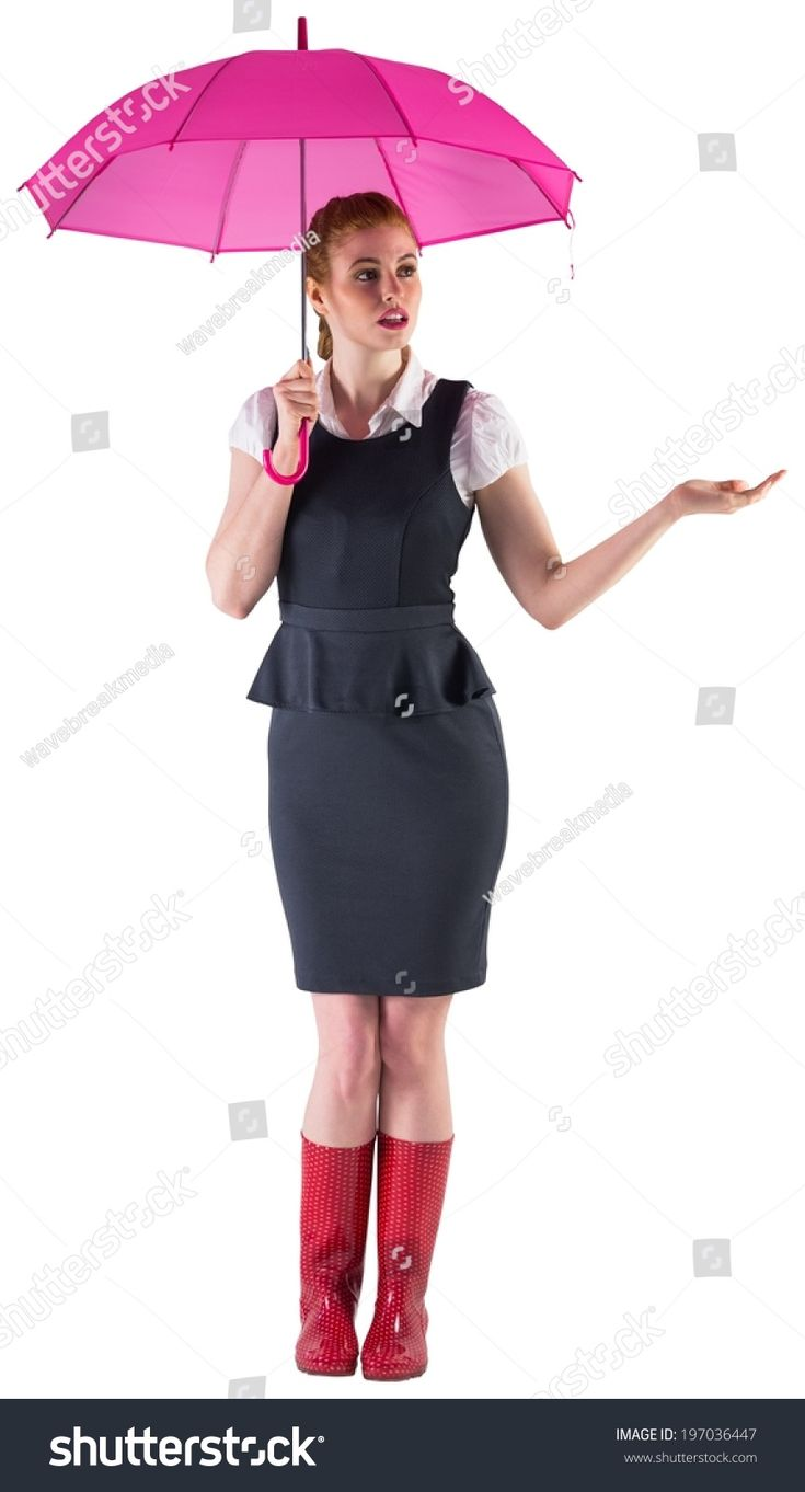 Pretty redhead businesswoman holding umbrella on white background