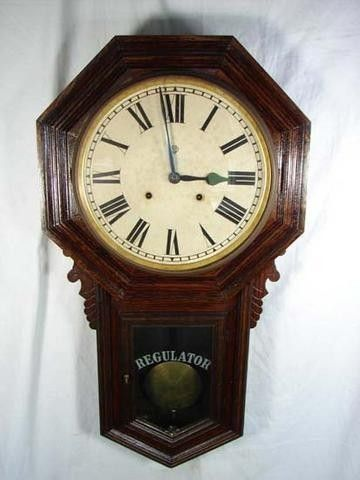 Antique Clock Wow! This auction is for an absolutely gorgeous antique wall regulator clock that has a very large dial and is constructed using an oak or walnut wood. It appears to have been refinished