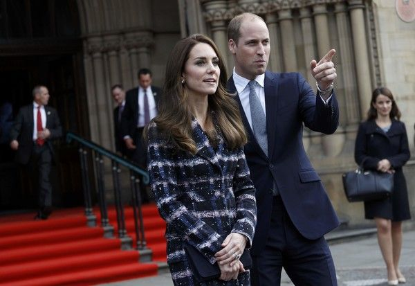 Kate Middleton Photos Photos - Prince William, Duke of Cambridge and Catherine, Duchess of Cambridge leave Manchester Town Hall after attending a paving stone ceremony for Victoria Cross recepients during their visit to Manchester on October 14, 2016 in Manchester, England. - The Duke & Duchess Of Cambridge Visit Manchester