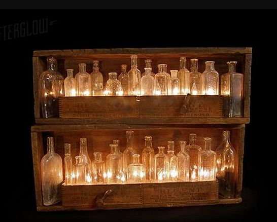 Lighting:  rope lights? behind old medicine bottles in wooden shelving.  (Urbanrevivaldesign.com)