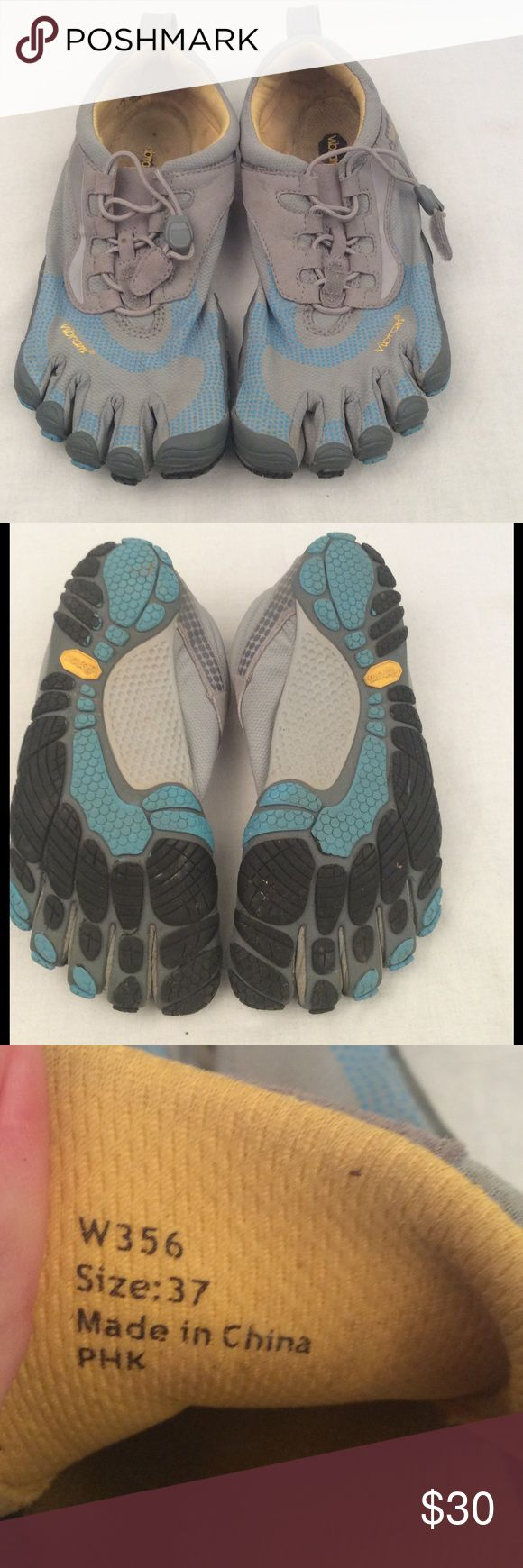 Women's Vibram Fivefinger Shoes Women's blue and gray fivefinger Vibram toe shoes, synches closed, in great condition, comes from a smoke free home. ✅Reasonable offers considered  ✅Bundle for a discount & save on shipping  ✅Same/next day shipping Vibram Shoes Athletic Shoes