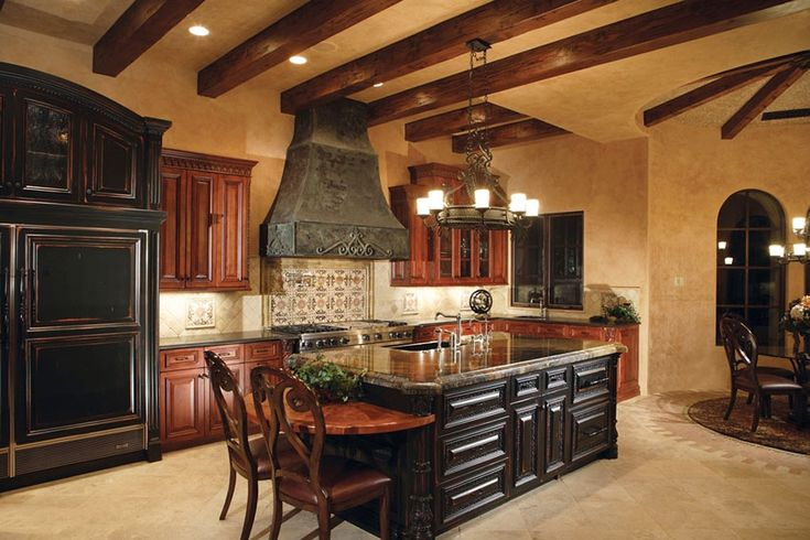 mediterranean-kitchen-with-dark cabinets-island-travertine-floors-and-marble-counters