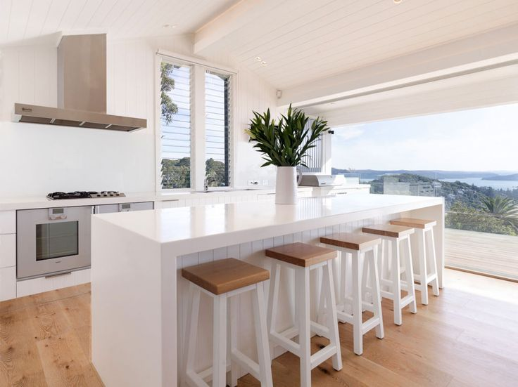 Kitchen views at Eco Outdoor featured project by Annabelle Chapman Architects. #livelifeoutdoors #naturalstoneflooringandwalling Annabelle Chapman Architects | River Run Constructions | Eco Outdoor | Sesame cobblestones | Berrimah traditional format walling | Outdoor design | Garden design | Outdoor paving | Outdoor design inspiration | Outdoor style | Outdoor ideas | Paving ideas | Contemporary garden design | Driveway ideas | Stone walling ideas | Outdoor tiles | Stone tiles | Luxury homes