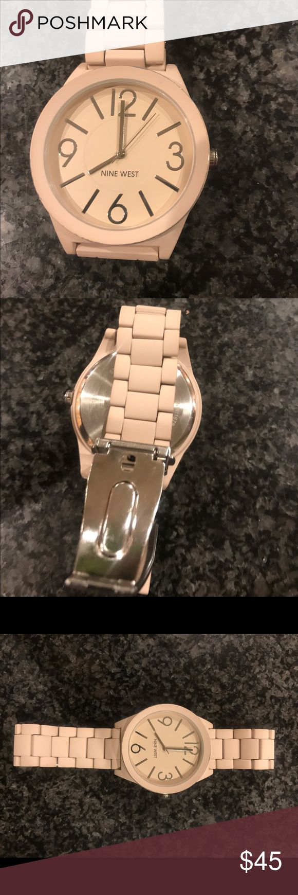 Nine West woman's pink watch This is a beautiful Nine West pink Large faced watch.. this watch does not come in a box  although packaged pretty. Nine West Accessories Watches