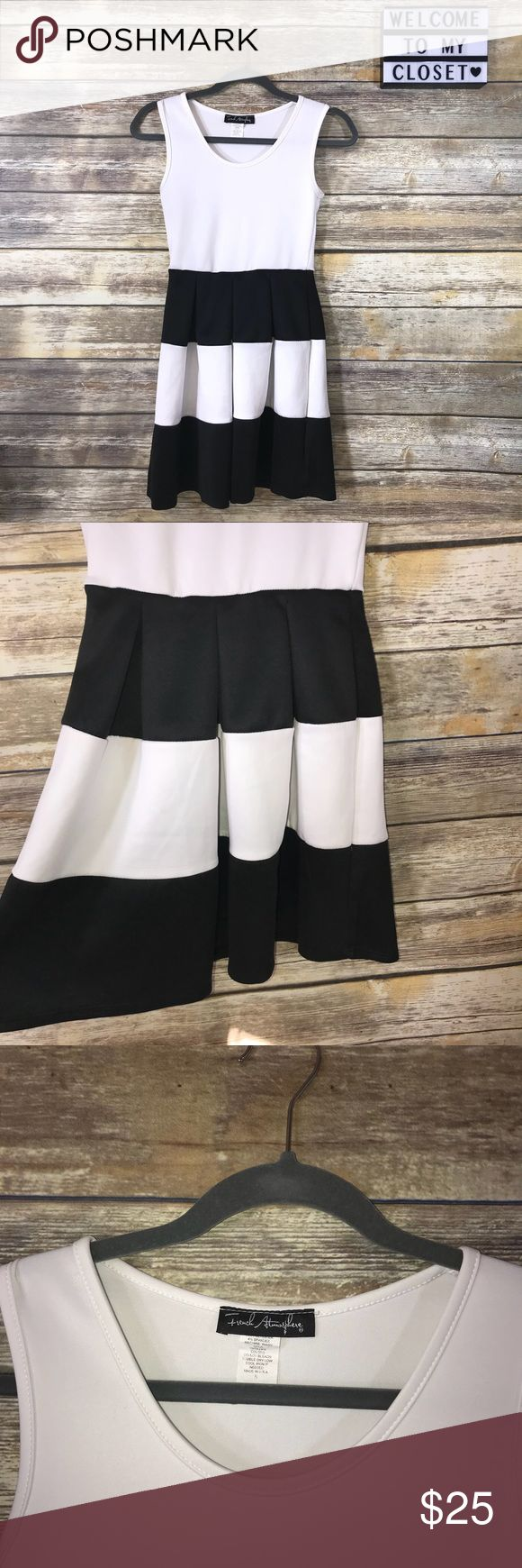 """Black and white cocktail dress Gorgeous black and white striped cocktail dress. In good condition. Size small. Underarm to underarm: 13"""". 
