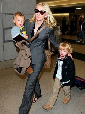 Cate rocking a black suit with kids in tow. Polished but not precious.  Love it.