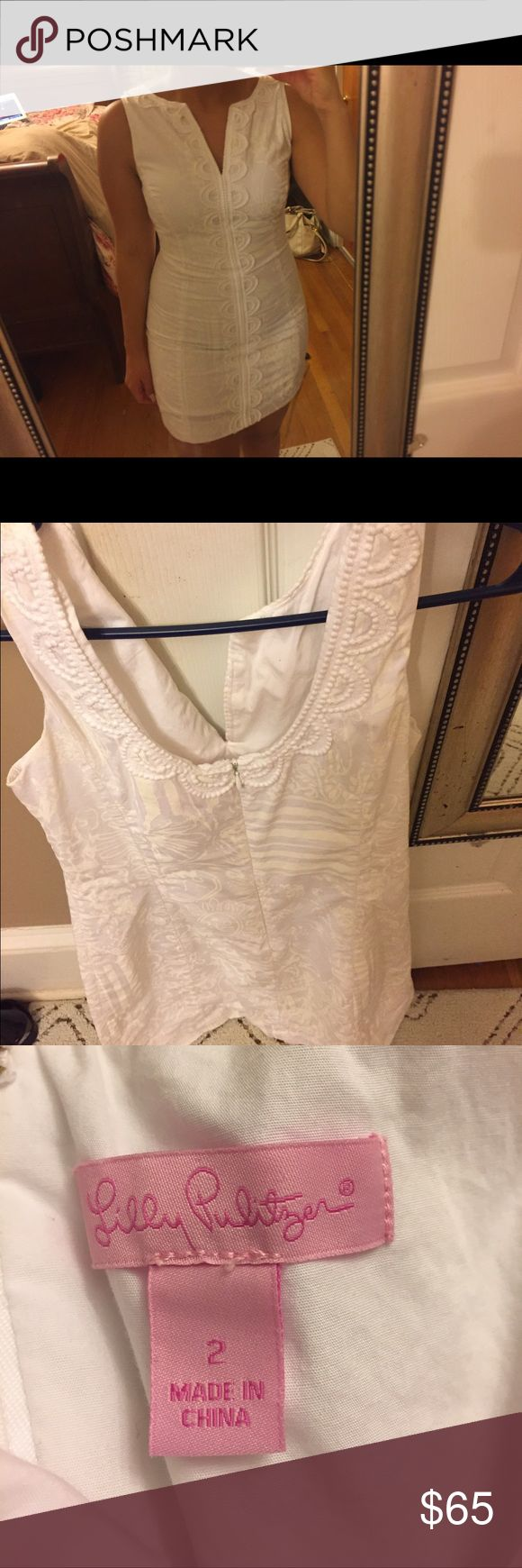 This is a lilly pulitzer white dress size 2 It was altered just a little, but still is a size 2. Make an offer!!! ❤️ Lilly Pulitzer Dresses Mini