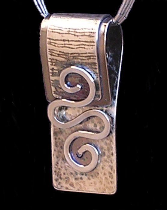 """Jennifer A. Hanscom, owner of """"Jenuine Article"""", Swirl as a rivet. In her work Jennifer, """"strives to combine form and function to compose works that depict the juxtaposition of logic and art. My designs result from exploring the patterning of shapes; and they celebrate the beauty of order."""""""