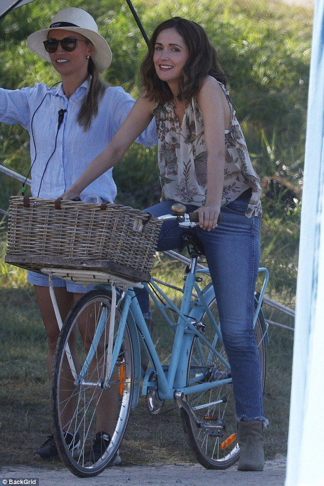 Rose Byrne looks carefree cycling on the set of Peter Rabbit #dailymail