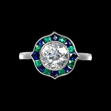 Brilliant cut diamond ring with sapphire and emerald surround in platinum. Art Deco or Art Deco style.