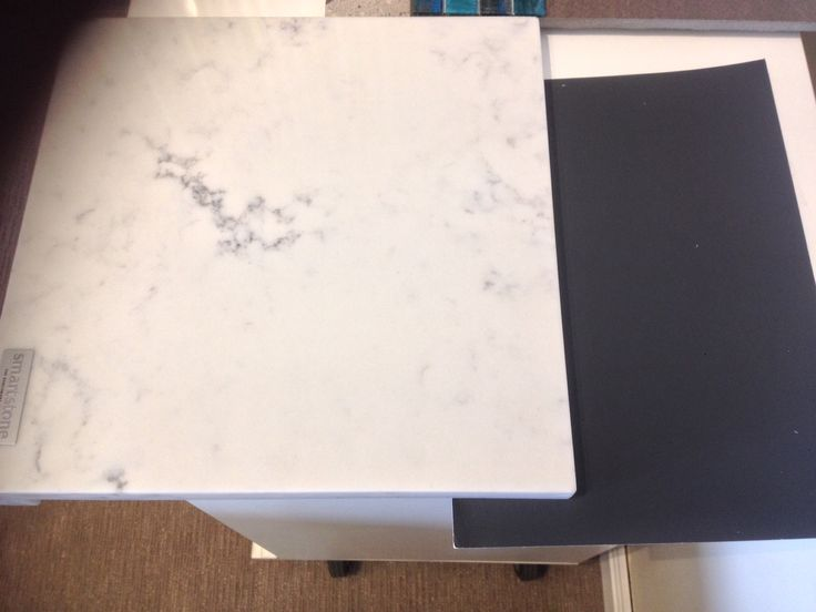 Smartstone Athena. New marble look stone composite. Looks great! Tracked down this sample today. Has only been out for a couple of weeks. Pictured here with a brush out sample of Resene Foundry... The colour of my kitchen island.